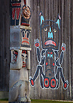 Blake Island State Park, WA  <br /> Totem pole stands in front of a painted  long house wall at Tillikum Village
