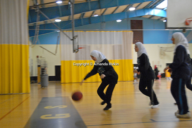 """Students from the Norr-ul-Iman school in South Brunswick, New Jersey warm up at the Islamic Games in South Brunswick, New Jersey on May 26, 2007.  The event website promised that """"If you can pray in it, you can play in it""""; over 600 Muslim youths from five states participated in the event."""