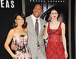 HOLLYWOOD, CA - MAY 26: (L-R) Actors Carla Gugino, Dwayne 'The Rock' Johnson and Alexandra Daddario arrive at the 'San Andreas' - Los Angeles Premiere at TCL Chinese Theatre IMAX on May 26, 2015 in Hollywood, California.