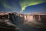 IS THIS HEAVEN? <br /> <br /> Pictured: The incredible moment a rainbow appears at the foot of Godafoss waterfall with the aurora of the Northern Lights illuminating overhead in Iceland. <br /> <br /> The breathtaking scene was captured by 59 year-old  Mauro Tronto. <br /> <br /> Computer scientist Mr Tronto drove across the country in search of the beautiful aurora, and hit the jackpot when a rainbow appeared at the 'waterfall of the gods'. <br /> <br /> Please byline: Mauro Tronto/Solent News<br /> <br /> © Mauro Tronto/Solent News & Photo Agency<br /> UK +44 (0) 2380 458800