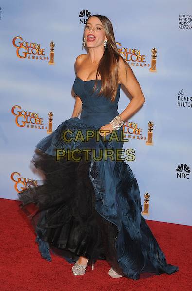 Sofia Vergara (wearing Vera Wang).Press Room at the 69th Annual Golden Globe Awards held at the Beverly Hilton Hotel, Hollywood, California, USA..January 15th, 2012.globes full length dress blue hand tulle lifting mouth open  peacock strapless mermaid gown funny.CAP/GDG.©GDG/Capital Pictures