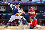 28 February 2011: New York Mets catcher Mike Nickeas is unable to get the tag on Wilson Ramos during a game against the Washington Nationals at Digital Domain Park in Port St. Lucie, Florida. The Nationals defeated the Mets 9-3 in Grapefruit League action. Mandatory Credit: Ed Wolfstein Photo