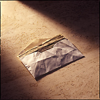 Envelope of money on marble background