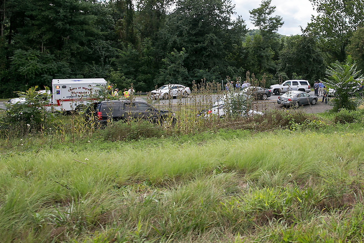 UNITED STATES - August 26: Virginia State Police, as well as local and federal authorities, investigate the scene on Interstate 66 eastbound where Vester Lee Flanagan II crashed his car after being pursued by state police near Linden, Va., Wednesday, August 26, 2015. Flanagan was being pursued after fatally shooting WDBJ-TV cameraman Adam Ward and reporter Alison Parker during an on-air interview in Moneta, Va. Flanagan was a former journalist at the television station, where he appeared on air as Bryce Williams. Photo By Al Drago/CQ Roll Call)