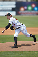 Kannapolis Intimidators starting pitcher John Parke (27) follows through on his delivery against the Lakewood BlueClaws at Kannapolis Intimidators Stadium on April 8, 2018 in Kannapolis, North Carolina.  The Intimidators defeated the BlueClaws 5-1 in game one of a double-header.  (Brian Westerholt/Four Seam Images)