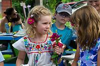 Two girls in garden camp at community garden, Maine, USA