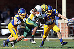 BROOKINGS, SD - SEPTEMBER 28:  John Crockett #23 from North Dakota State University looks for running room past R.C. Kilgore #42 and T.J. Lalley #33 from South Dakota State University in the second quarter of their game Saturday afternoon at Coughlin Alumni Stadium in Brookings. (Photo by Dave Eggen/Inertia)
