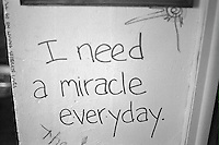 """Graffiti inside of college house; """"I need a miracle every day.""""  Champaign Illinois USA"""