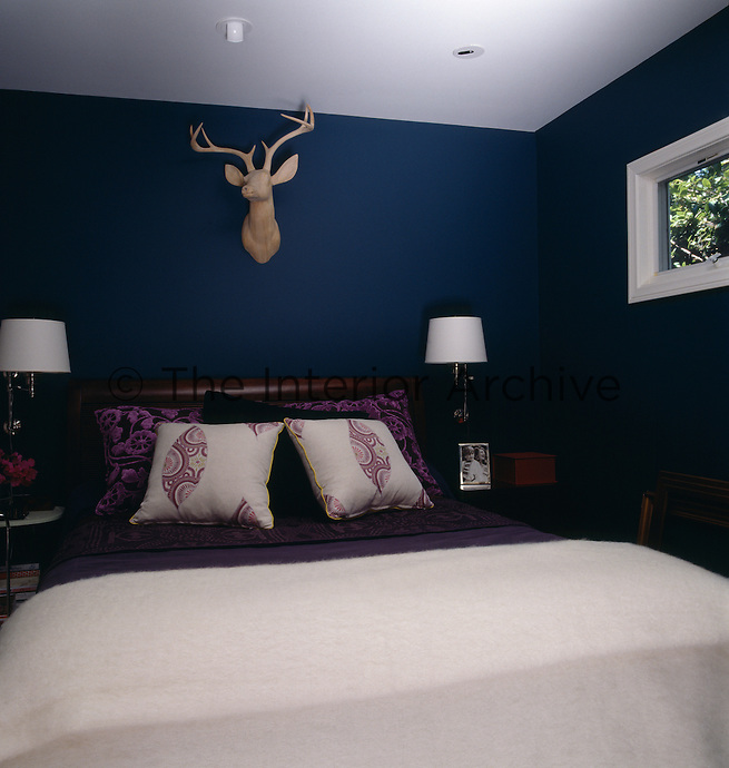 All the bedrooms in the property are small and decorated in dark colours