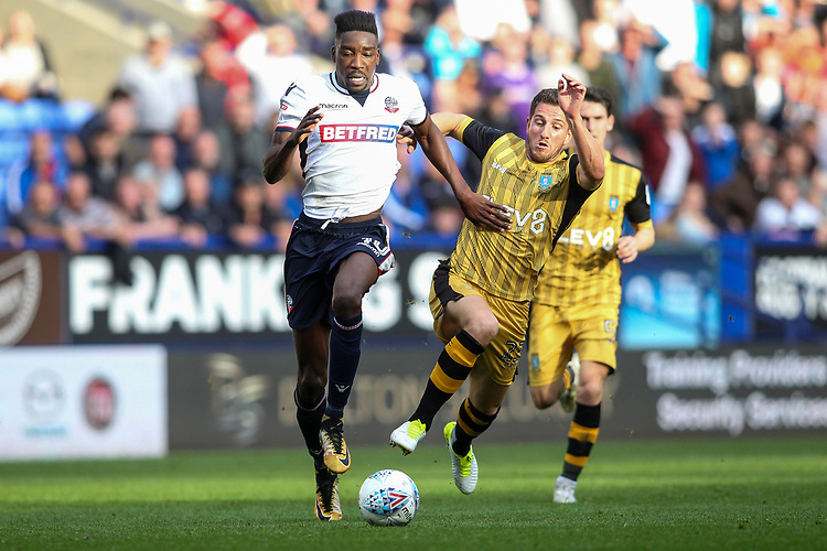 Bolton Wanderers'  Sammy Ameobi competing with Sheffield Wednesday's Sam Hutchinson<br /> <br /> Photographer Andrew Kearns/CameraSport<br /> <br /> The EFL Sky Bet Championship - Bolton Wanderers v Sheffield Wednesday - Saturday 14th October 2017 - Macron Stadium - Bolton<br /> <br /> World Copyright &copy; 2017 CameraSport. All rights reserved. 43 Linden Ave. Countesthorpe. Leicester. England. LE8 5PG - Tel: +44 (0) 116 277 4147 - admin@camerasport.com - www.camerasport.com