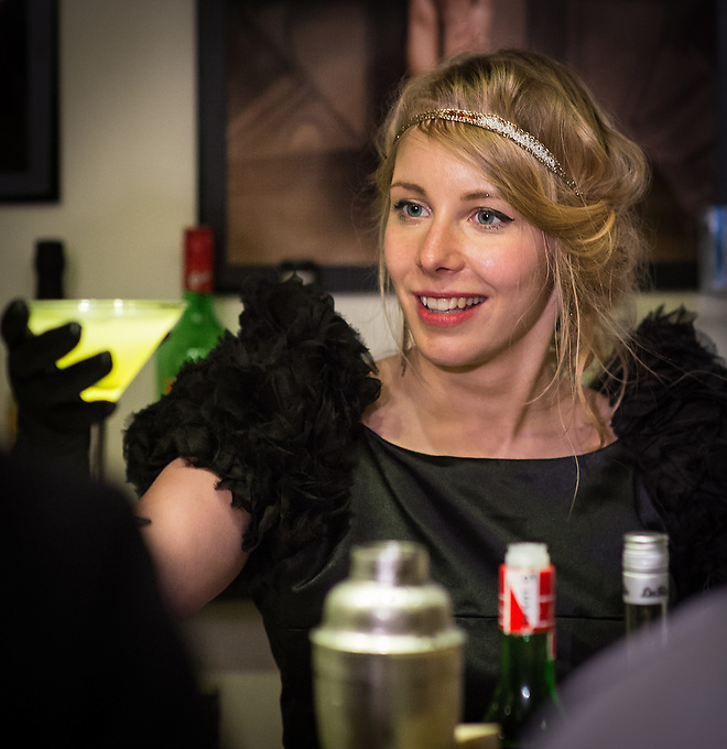 Claire Glanois mixing cocktails during an evening at Paris Boogie Speakeasy, the unique and exclusive club at 256 Rue Marcadet founded and run by Yves Riquet, director of Cervin Hosiery and official historian of the Crazy Horse. The evening was a tribute to Sidney Bechet, with outstanding music played by several pianists, clarinettists, saxophonist and drummer, including Lou Lauprète (piano), Christophe Benz (piano), Mokar Nirek (piano), Annie Terramosi (clarinet), and Gabrielle Janselme (singer). Also attending were Céline Pruvost (musician and singer), and Paul Loup Sulitzer. Paris Boogie Speakeasy has been credited by L'Express as being one of the most exciting places in Paris (l'un des spots les plus amusants de Paname!). Sunday 19th May 2013.