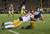 Troy Niklas (85) catches a pass for a touchdown as USC Trojans linebacker Hayes Pullard (10) defends in the first quarter.