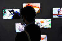 HONG KONG - MARCH 12:  A visitor looks at animation 'Everything is everything' by Koki Tanaka, as part of the exhibition 'Moving Images' organized by M+ organization on March 12, 2015 in Hong Kong, Hong Kong.  (Photo by Lucas Schifres/Getty Images)