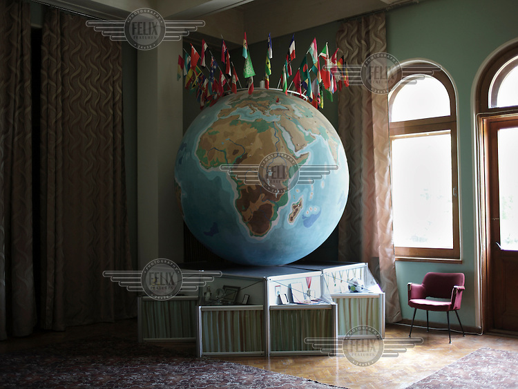 Flags stick out of a large globe at Artek museum. Artek is a youth camp in Gurzuf.