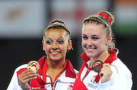 England's Rebecca Downie, left, with her gymnastics artistic women's uneven bars final gold medal and silver medalist England 's Larrissa Miller<br /> <br /> Photographer Chris Vaughan/CameraSport<br /> <br /> 20th Commonwealth Games - Day 8 - Thursday 31st July 2014 - Gymnastics - The SSE Hydro - Glasgow - UK<br /> <br /> © CameraSport - 43 Linden Ave. Countesthorpe. Leicester. England. LE8 5PG - Tel: +44 (0) 116 277 4147 - admin@camerasport.com - www.camerasport.com