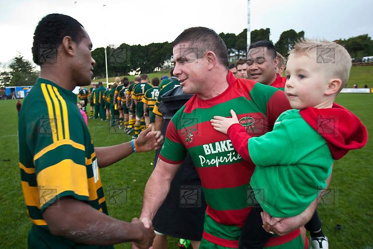 Victorious captain Grant Henson shakes the hand of Pukekohe's David Raikuna. Counties Manukau McNamara Cup Premier Club Rugby final between Pukekohe andWaiuku, held at Bayer Growers Stadium, on Saturday July 17th. Waiuku won 25 - 20.