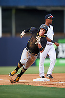 Bradenton Marauders second baseman Mitchell Tolman (5) rounds third base in front of Abiatal Avelino (22) during the first game of a doubleheader against the Tampa Yankees on April 13, 2017 at George M. Steinbrenner Field in Tampa, Florida.  Bradenton defeated Tampa 4-1.  (Mike Janes/Four Seam Images)