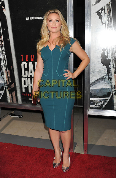 Elisabeth Rohm<br /> Premiere of &quot;Captain Phillips&quot; held at the Academy of Motion Picture Arts and Sciences, Beverly Hills, California, USA.<br /> September 30th, 2013<br /> full length green dress hand on hip<br /> CAP/ROT/TM<br /> &copy;Tony Michaels/Roth Stock/Capital Pictures