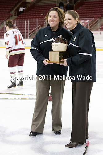 Courtney Kennedy (BC - Assistant Coach), Katie King (BC - Head Coach) - The Boston College Eagles defeated the Harvard University Crimson 3-1 to win the 2011 Beanpot championship on Tuesday, February 15, 2011, at Conte Forum in Chestnut Hill, Massachusetts.