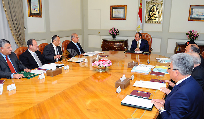 Egyptian President Abdel Fattah al-Sisi chairs a meeting with Egyptian Prime Minister Sharif Ismail and Egyptian officials in Cairo, Egypt, on December 21, 2016. Photo by Egyptian President Office