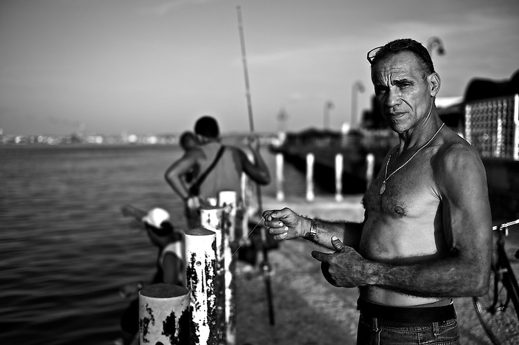 Images from the old Havana, Cuba.  ..Alcides is just another of the many Cubans wholove to fish.  He fises every day, from sunset to dusk.