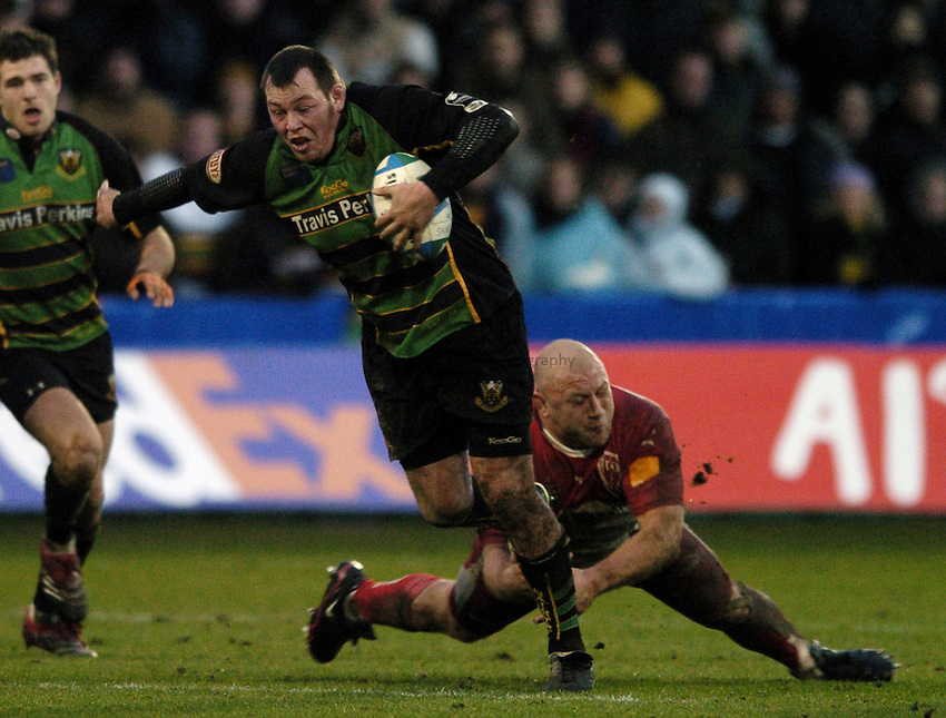 Photo: Jonathan Butler..Northampton Saints v Biarrtiz. Heineken Cup. 21/01/2007..Steve Thompson of Northampton Saints is tackled by Petru Balan of Biarritz