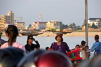 Phnom Penh, Cambodia. Evening rush hour seen from aboard a Tuk Tuk. Tonle Sap.