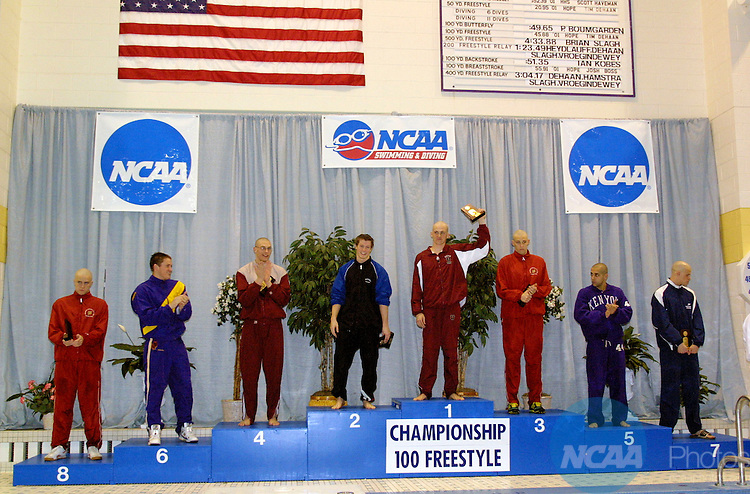 19 MAR 2005:  The top eight finishers in the 100 yard freestyle competition mount the podium during the NCAA Men's Division 3 Swimming and Diving championship hosted by Hope College  at the Holland Community Aquatic Center in Holland, MI. Elliot Seguin of Union College placed first in the 100 yard freestyle competition to win the championship title.  John Lacko/NCAA Photos