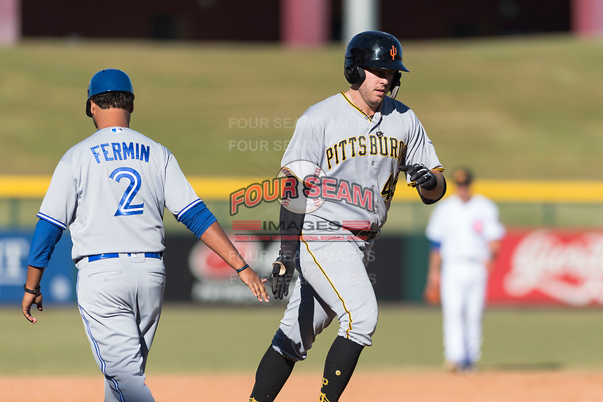 Surprise Saguaros first baseman Will Craig (45), of the Pittsburgh Pirates organization, is congratulated by third base coach Andy Fermin (2), of the Toronto Blue Jays organization, after hitting a home run during an Arizona Fall League game against the Mesa Solar Sox at Sloan Park on November 15, 2018 in Mesa, Arizona. Mesa defeated Surprise 11-10. (Zachary Lucy/Four Seam Images)