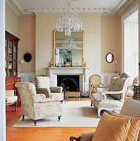 A generously proportioned Georgian drawing room with a mix of English and French furniture.