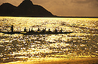 Outrigger canoe teams at sunrise, with the moku lua islands in rear, Kailua, oahu
