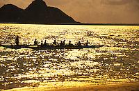 Outrigger canoe teams at sunrise, with the moku lua islands in rear, Kailua, oahu