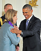 United States President Barack Obama presents the 2012 National Medal of Arts to Renée Fleming during a ceremony in the East Room of the White House in Washington, D.C.  on Wednesday, July 10, 2013.<br /> Credit: Ron Sachs / CNP