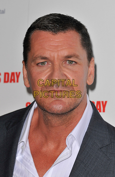 Craig Fairbrass .The 'St George's Day' world film premiere, Odeon Covent Garden cinema, Shaftesbury Avenue, London, England..August 29th, 2012.headshot portrait white shirt grey gray stubble facial hair .CAP/WIZ.© Wizard/Capital Pictures.