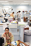 Dental hygiene students, including Val Garcia (foreground), examine patients in the Georgia Perimeter College's Dunwoody Campus Dental Clinic in Dunwoody, Georgia October 6, 2011. The clinic is four days a week and there are 18 units that are often full of patients during the clinics.