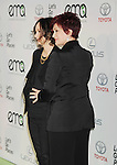 BURBANK, CA- OCTOBER 18: Actress/TV personality Sara Gilbert (L) and TV personality Sharon Osbourne arrive at the 2014 Environmental Media Awards at Warner Bros. Studios on October 18, 2014 in Burbank, California.