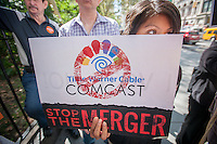 Activists protest outside of City Hall in New York on Monday, September 15, 2014 to demand protections for Net Neutrality and to reject the proposed merger between Comcast and Time Warner Cable. Organized by the group Free Press, the supporters called on the Federal Communications Commission to adopt rules that would prevent broadband providers from discriminating  against online services and content. The final day for public comments to the FCC is today. (© Richard B. Levine)