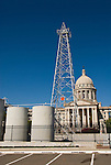 Oklahoma State Capitol Building, Phillips 66 oil drilling derrick with petroleum tanks in the parking lot