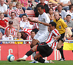 Sunderland's Kieran Richardson and Juventus' Jonathan Zebina...Pre-Season Friendly..Sunderland v Juventus..4th August, 2007..--------------------..Sportimage +44 7980659747..admin@sportimage.co.uk..http://www.sportimage.co.uk/