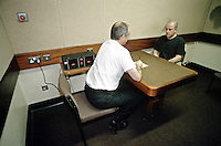 Prisoner taking part in a taped interview by the custody sergeant. This image may only be used to portray the subject in a positive manner..©shoutpictures.com..john@shoutpictures.com