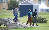 4th October 2017, The Old Course, St Andrews, Scotland; Alfred Dunhill Links Championship, practice round; Actors Matthew Goode and Jamie Dornan and Former Ireland rugby captain Brian O'Driscoll cross the Swilken Bridge on the Old Course, St Andrews during a practice round before the Alfred Dunhill Links Championship