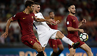 Calcio, Serie A: Roma, stadio Olimpico, 26 agosto, 2017.<br /> Inter's captain Mauro Icardi (c) in action with Roma's Kostas Manolas (r) and Federico Fazio (l) during the Italian Serie A football match between Roma and Inter at Rome's Olympic stadium, AUGUST 26, 2017.<br /> UPDATE IMAGES PRESS/Isabella Bonotto
