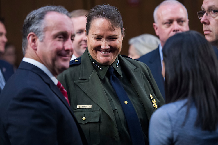"UNITED STATES - JULY 31: Carla L. Provost, acting chief of the U.S. Border Patrol, and Matthew T. Albence, left, executive associate director for Enforcement and Removal Operations, U.S. Immigration and Customs Enforcement (ICE), arrive for a Senate Judiciary Committee hearing in Hart Building titled ""Oversight of Immigration Enforcement and Family Reunification Efforts,"" on July 31, 2018. (Photo By Tom Williams/CQ Roll Call)"