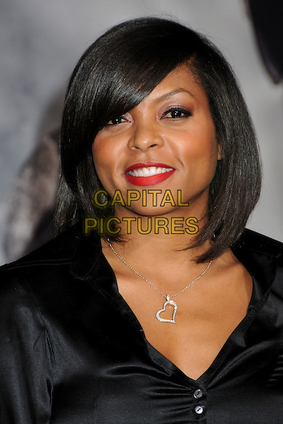 "TARAJI P. HENSON.at Alcon Entertainment's L.A. Premiere of ""The Book of Eli"" held at The Chinese Theatre in Hollywood, California, USA, .January 11th 2010. .portrait headshot red lipstick bob make-up smiling silver heart necklace black silk satin .CAP/ADM/BP.©Byron Purvis/AdMedia/Capital Pictures."