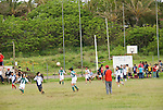 Chile, Easter Island: Young men playing soccer downtown Hanga Roa..Photo #: ch322-32988.Photo copyright Lee Foster www.fostertravel.com lee@fostertravel.com 510-549-2202
