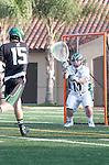 La Canada Flintridge, CA 03/16/13 - Jake Stott (Coronado #15) and Payden Dickerson (De La Salle #10) in action during the De La Salle vs Coronado lacrosse game at St Francis High School.  De La Salle defeated Coronado 8-5.