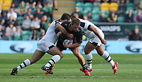 Northampton Saints's Alex Waller is tackled by Clermont Auvergne's Etienne Falgoux (left) and John Ulugia (right)<br /> <br /> Photographer Stephen White/CameraSport<br /> <br /> European Rugby Challenge Cup - Northampton Saints v Clermont Auvergne - Saturday 13th October 2018 - Franklin's Gardens - Northampton<br /> <br /> World Copyright © 2018 CameraSport. All rights reserved. 43 Linden Ave. Countesthorpe. Leicester. England. LE8 5PG - Tel: +44 (0) 116 277 4147 - admin@camerasport.com - www.camerasport.com