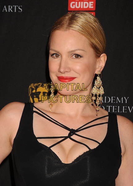 Alice Evans.BAFTA Los Angeles 2011 Britannia Awards held at the Beverly Hilton Hotel, Beverly Hills, California, USA..November 30th, 2011.headshot portrait black straps red lipstick gold dangling earrings .CAP/ROT/TM.©Tony Michaels/Roth Stock/Capital Pictures