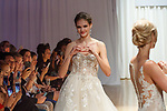 Models walk runway in a bridal gowns from the Amaré Couture collection at the Casablanca Bridal 20th anniversary celebration runway show, on October 8, 2017; during New York Bridal Fashion Week Spring 2018.