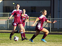 Westside Eagle Observer/RANDY MOLL<br /> Gentry seniors Ariel Nix and Ahrya Reding, behind junior Emily Hays, move the ball downfield against Berryville during play in Gentry on March 10, 2020.